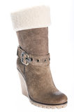 Women's beige suede boots on a high platform sole. Royalty Free Stock Photos