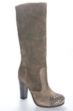 Women's beige suede high-heeled boots. Stock Images