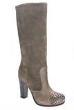 Women's beige suede high-heeled boots. Stock Photo