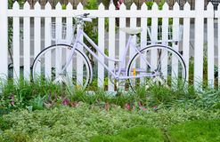 Women's bicycl lean at white  fence Stock Photo