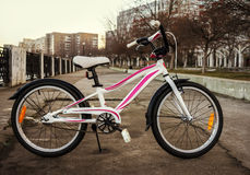 Women's bike in a retro-style, white with pink stripes Royalty Free Stock Photos