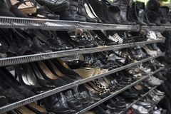 Women`s Black Colored Pumps, Shoes, Sandals, Thrift Store Shelves royalty free stock photo