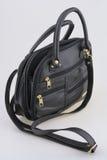 Women's black leather handbag. Small ladies leather bag on a white background Stock Photo