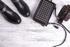 Women`s black leather handbag on wooden floor Royalty Free Stock Photos