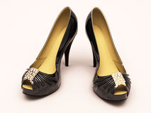 Women's black shoes closeup. On a light background Stock Photos