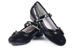 Women's black shoes on white Royalty Free Stock Image