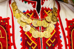 Women`s blouse with colorful hand-embroidered embellished with a necklace of gold coins Royalty Free Stock Photos