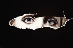 Women's blue eyes spying Royalty Free Stock Images