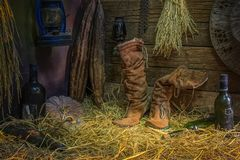 Women& x27;s Boots with Old Bottle Whiskey or old bottle wine and Eq royalty free stock image