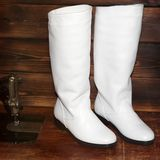 Women`s boots on wooden background. White skin stock images