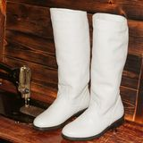 Women`s boots on wooden background. White skin stock photo