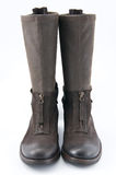 Women's brown leather boots with low heels. 