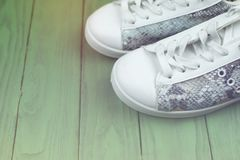Women`s casual sneakers are white-turquoise royalty free stock photos