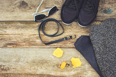 Women`s clothing and accessories: grey sweater, jeans, belt, sneakers, sunglasses, yellow leaves Stock Photo