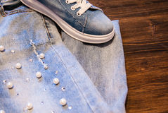 Women`s clothing and accessories. Jeans, purse and shoes. Stock Photography