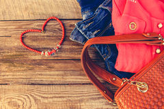 Women's clothing and accessories sweater, jeans, handbag, beads Stock Images