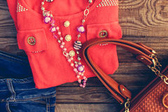 Women's clothing and accessories sweater, jeans, handbag, beads Royalty Free Stock Photo