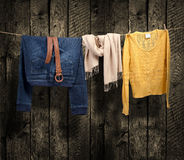 Women's clothing on a clothesline on wood background Royalty Free Stock Photos