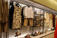 Women Clothing Store. A section of a women's clothing store at a mall. Dresses, pants, hats, bags and shoes Stock Photo