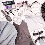 Women`s clothing, skin care and cosmetics is located on a white Royalty Free Stock Images