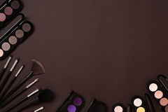 The women`s cosmetics set on a brown background, modern woman. Royalty Free Stock Photo
