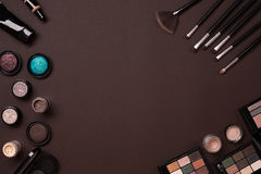 The women`s cosmetics set on a brown background, modern woman. Stock Photos