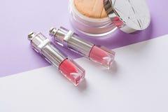 Women`s cosmetics on a white background. powder and lipstick flat lay. pink lip gloss .copy space stock photo