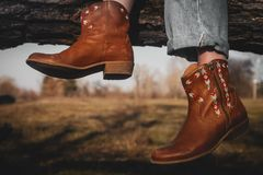 Women`s cowboy boots. At nature background royalty free stock image