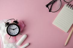 Women`s cycle hyhienic pads and tampons on pink background. Copy space. Image stock image