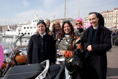 Women's Day: bikers meet nuns. Marseille, France: March 6th, 2011. Motorcycle rally for the Women's Day in the Vieux-Port, Marseille,FR royalty free stock photo