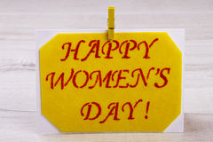 Women`s Day card with clothespin. Stock Photography
