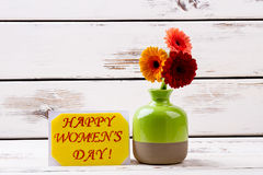 Women`s Day card and gerberas. Stock Photography