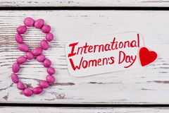 Women`s day card and heart. Creative surprise for her royalty free stock image