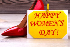 Women`s Day card and shoe. Clothespin on fabric greeting card. Fashion as part of celebration. Creativity on every holiday Royalty Free Stock Images