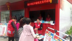 Shenzhen, China: the community carries out pre-pregnancy eugenics publicity activities on women`s day. Women`s day, the community to carry out pre-pregnancy stock footage