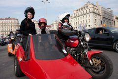 Women's Day: a family of bikers. Marseille, France: March 6th, 2011. Motorcycle rally for the Women's Day in the Vieux-Port, Marseille,FR royalty free stock images