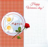 Women`s day greeting card with number eight shaped omelet on pla. Happy women`s day greeting card with number eight shaped fried eggs on plate with ketchup Stock Photo