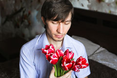 Women's day, the guy with red tulips Stock Photo
