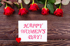 Women`s Day heart and roses. Women`s Day card and flowers. Roses of red color. Make a surprise for wife. Simple but elegant gift stock images