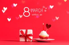 Women`s Day message with cupcake and heart Stock Photography