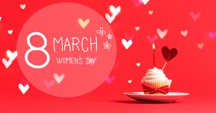 Women`s Day message with cupcake and heart. Ornament Stock Photos
