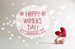 Women`s Day message with toy car carrying a heart. Cushion royalty free stock photo