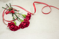Women`s day. Red flowers in the bouquet for a burning girl as a gift Stock Photo
