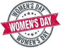 Women`s day red round grunge vintage stamp. Women`s day red round grunge vintage ribbon stamp Stock Image