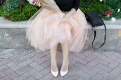 Women`s Day woman with flowers tutu skirt heel waiting joy Stock Images