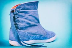 Women`s denim boots on a colored background. royalty free stock photography