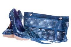 Women's denim shoes and denim clutch bag Stock Image