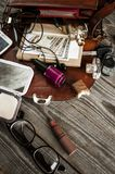 Women`s things scattered from the bag. Women`s different  things scattered from the bag on wooden boards Stock Photography