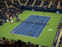 Ashe Stadium - US Open Tennis. A women`s doubles match in 2017 on the under the roof at the US Open Tennis Championship Stock Photography