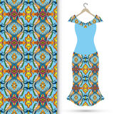 Women's dress on a hanger and seamless geometric pattern Stock Image
